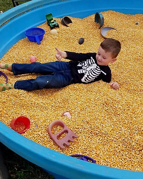 corn_play_cornbox_young boy