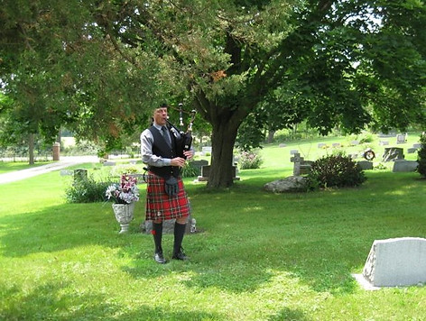 Chicago Pipe & Drums Piper at a Grave Marking Ceremony of a member
