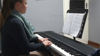 Practicing reading and playing for future singing.mp4