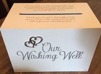 White box wishing well.