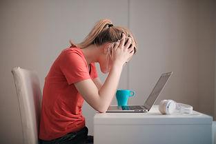 Stress Girl at Desk.jpg