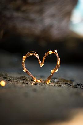 lighted wire heart on beach.jpg