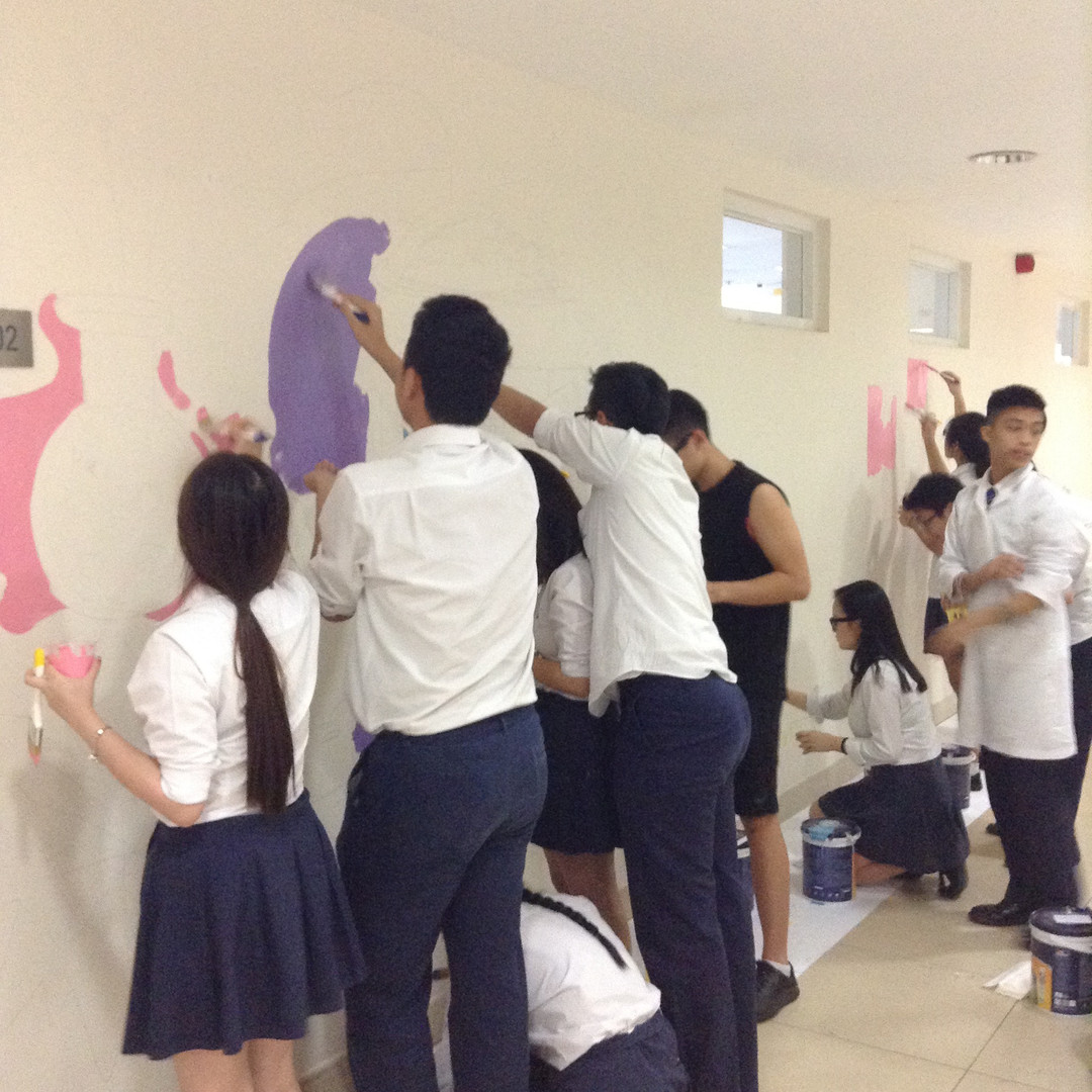 Art students working on mural