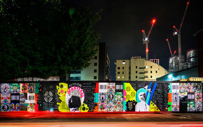 'We are one family' mural on Freston Road