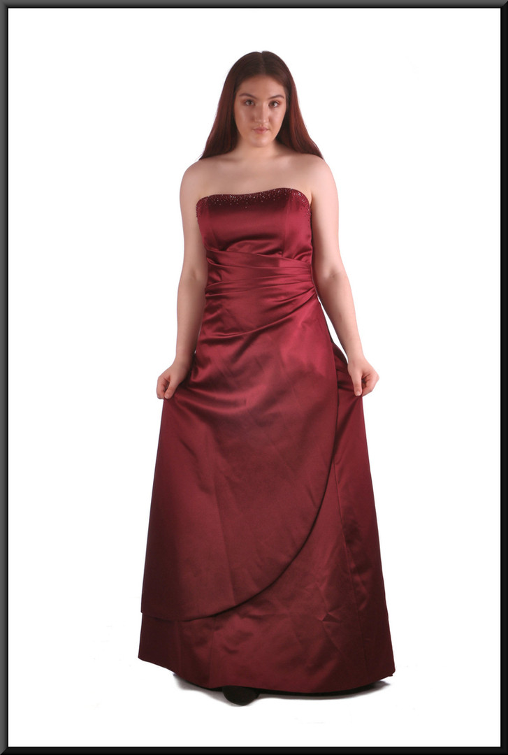 Full length strapless evening dress with delicate diamanté along top of angular ruched bodice, dark burgundy, size 14