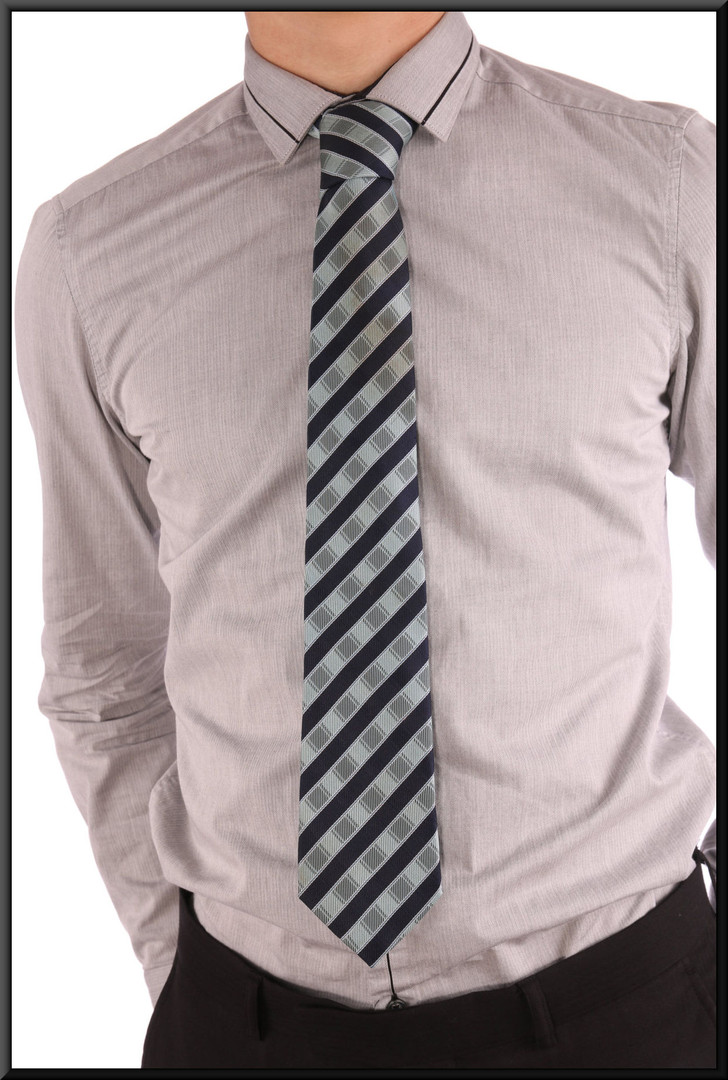 Two tone blue striped tie, with lighter coloured bands having slightly luminescent surface