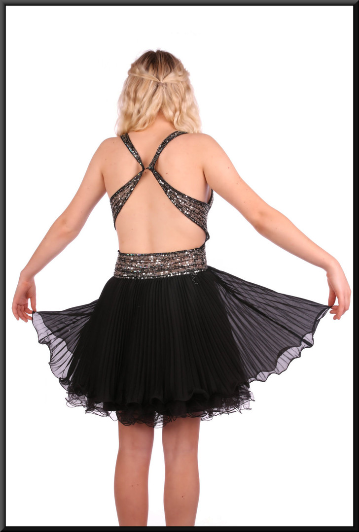"""Multi-layer voile and net dress over satin mini-skirt topped with sequinned backless bodice, size 4in black Model height 5'2"""""""