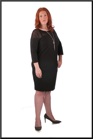 Knee length black with white pin-stripe dress with mesh translucent shoulders and sleeves - size 20