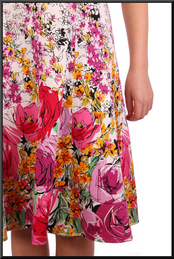 "Rose patterned summer mini-dress on a white background, size 4 / 6 in multiplepastel colours on white Model height 5'2"""