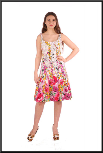 """Size 8 / 10 Rose patterned summer mini-dress on a white background - multi pastel colours on white; model height 5'5"""".  Also fits a slimmer model and is shown in the size 4 and 6 pages"""