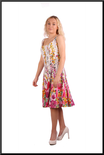 """Size 4 / 6 (but the cut allows it to be worn up to size 10)Rose patterned summer mini-dress on a white background - multi pastel colours on white; model height 5'2"""".  Also fits slightly fuller model and is shown in the size 8 and 10 pages"""