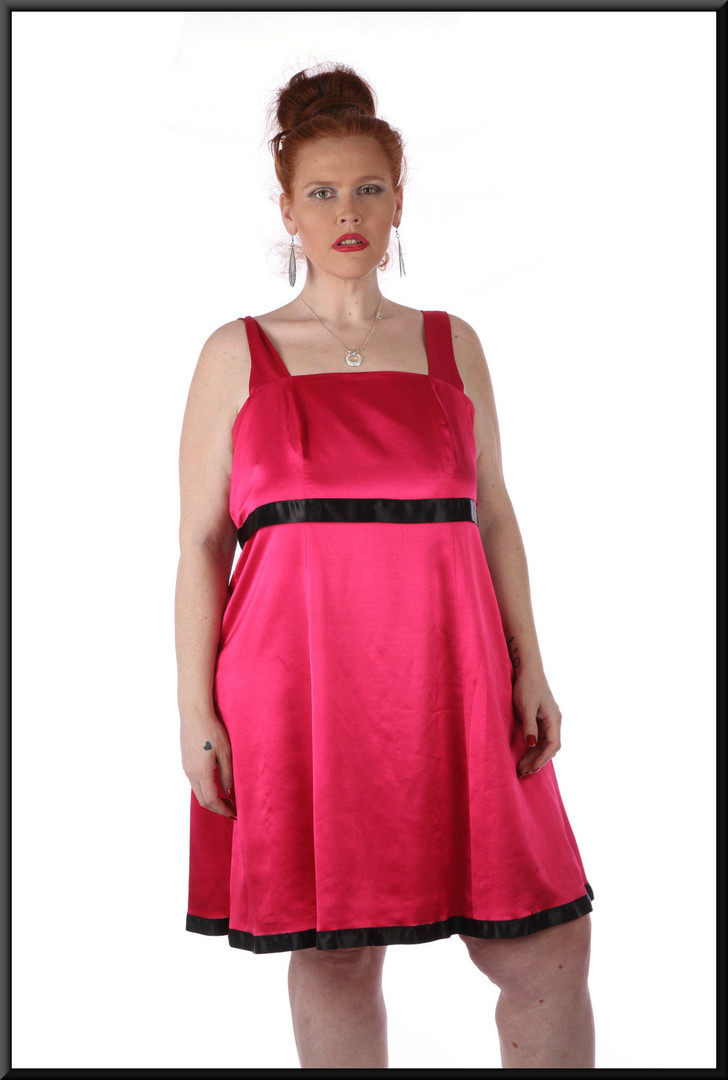 Simple satinette mini dress with black pseudo-belt and hem line, size 18 in shocking pink.  Model height 5'7""