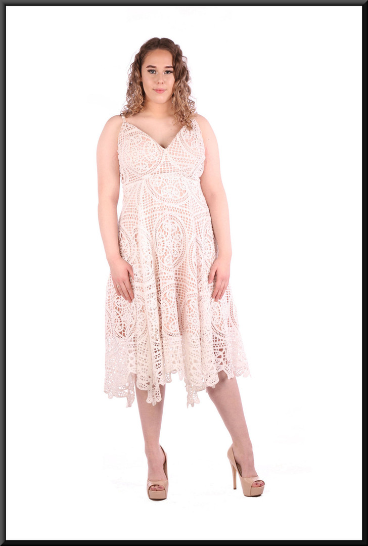 Crochet effect over satinette under-dress, three quarter length, size 12 / 14 in off white over pink.  Model height 5'7""