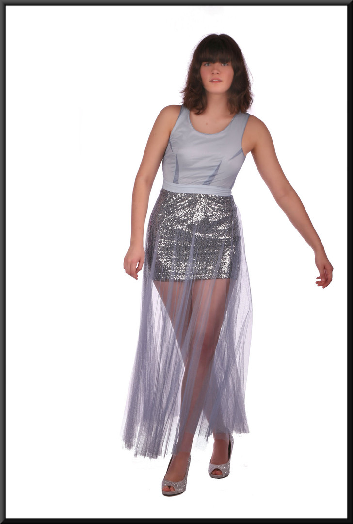Sequinned mini skirt with flowing chiffon over-skirt and panelled bodice, pale blue over silver.
