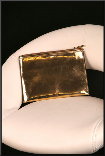 Gold coloured shiny clasp bag