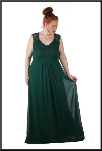 Size 18/20 100% polyester silk-effect over velvet effect skirt c/w pseudo-crochet bust - bottle green