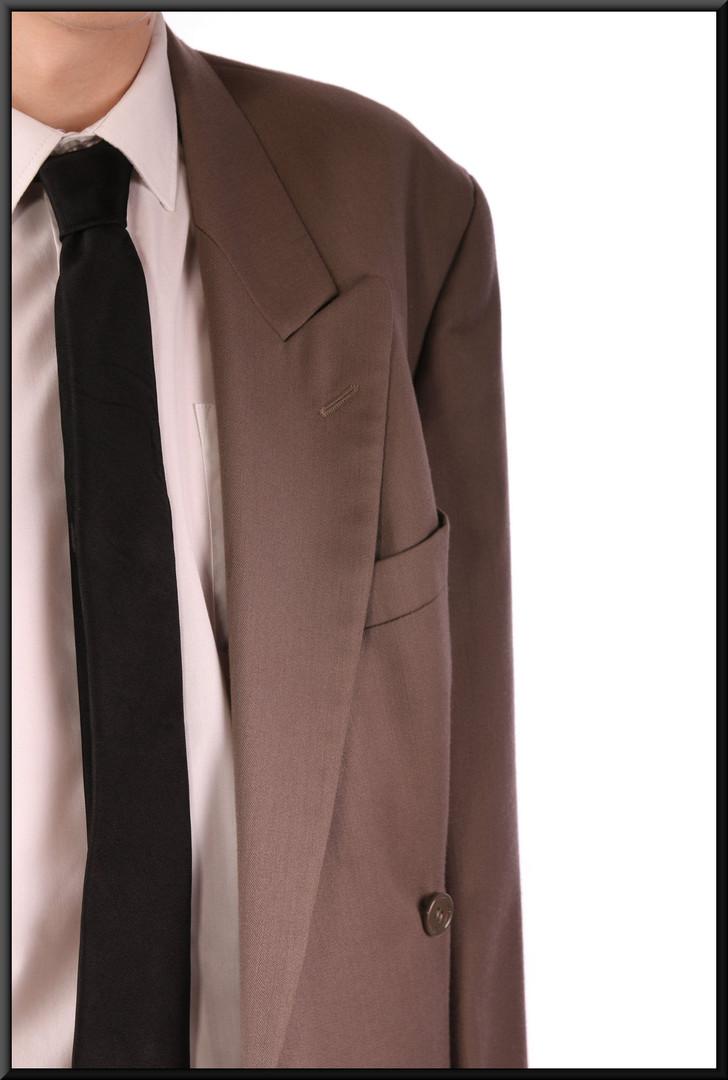"Two-piece men's suit, mid tan, chest NK, waist 21, leg S Model height 5'11"""