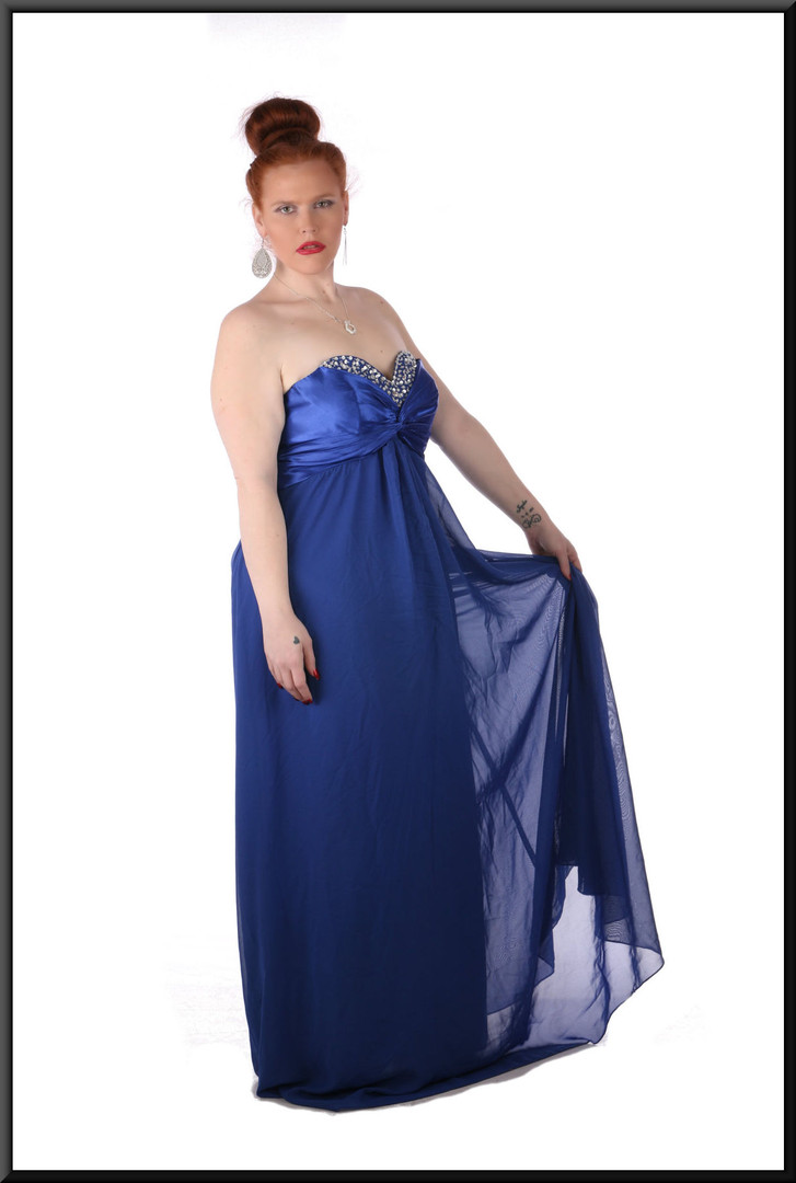 """Satin strapless full length dress with boned and padded bust, corset tie back and net skirt, size 20 in royal blue. Model height 5'7"""""""