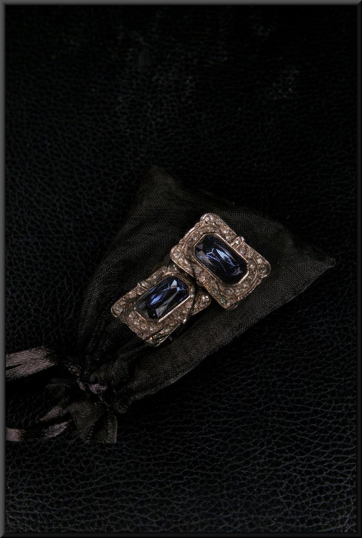 Amethyst effect earrings set in a silver effect base