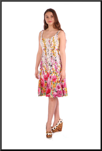 """Size 8 / 10 Rose patterned summer mini-dress on a white background - multi pastel colours on white; model height 5'5"""".  Also fits slimmer model and is shown in the size 4 and 6 pages"""
