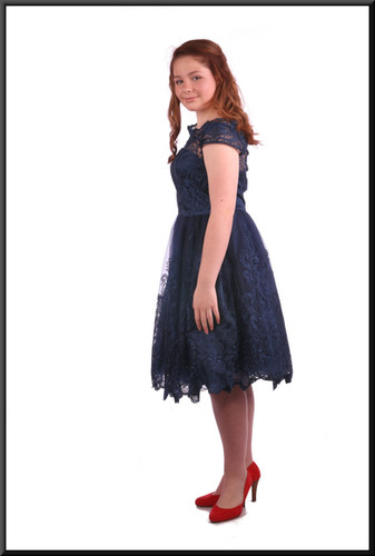 "Below the knee layered net over satinette dress - dark royal blue, size 12; model height 5'4"".  Red ""Dorothy"" shoes see Accessory cat.no. A014."