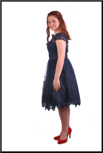 """Below the knee layered net over satinette dress - dark royal blue, size 12; model height 5'4"""".  Red """"Dorothy"""" shoes see Accessory cat.no. A014."""