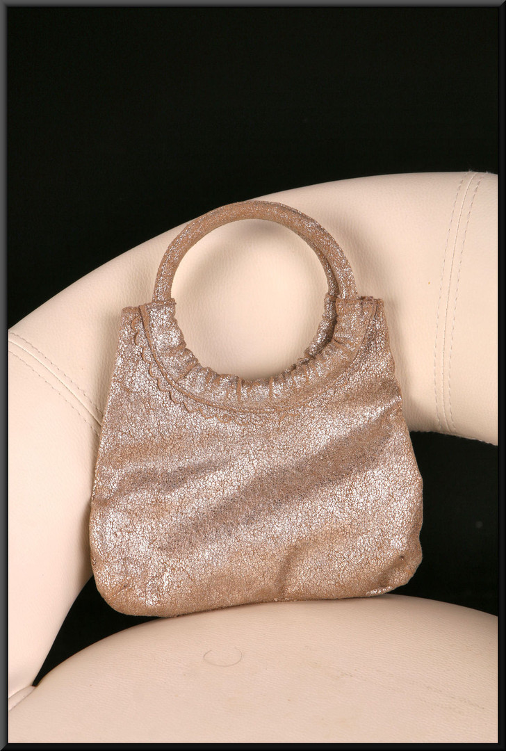 Simple white gold glitter effect hand pouch