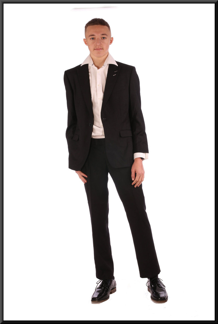 "Men's evening suit, jacket size not marked, trouser 32"" short - worn with shirt cat. no. 157.  Model height 5'11"""