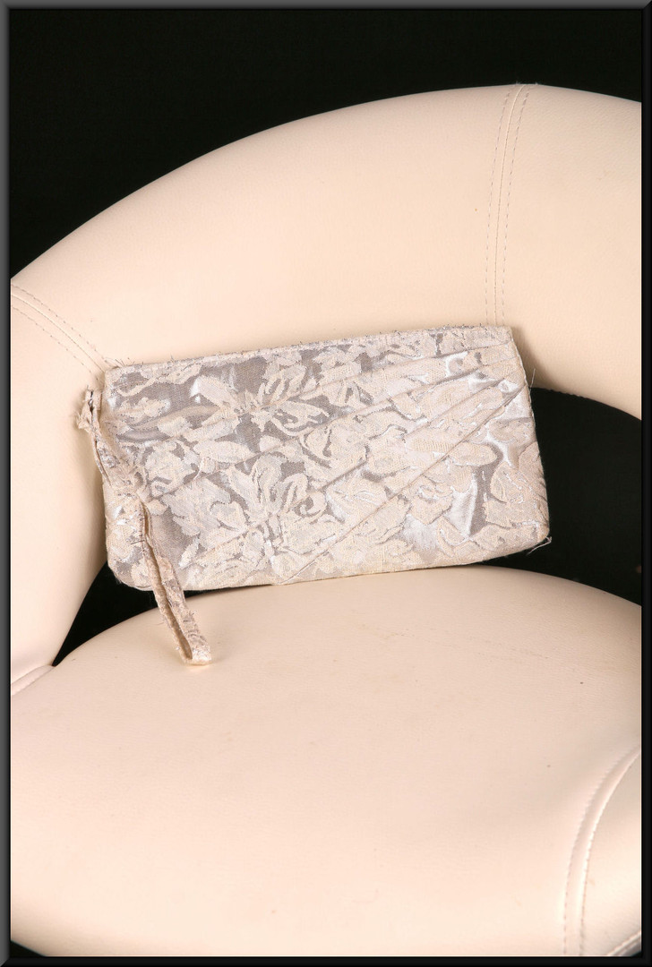 Soft fabric silver coloured embroidered clasp bag