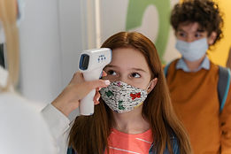 teacher-with-medical-mask-checking-child