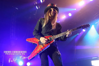 Bret Michaelsand CC Deville performs with Poison at Hard Rock Event Center at the Seminole Hard Roc