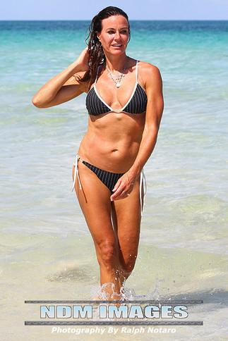 Kelly Bensimon shows off her bikini body on South Beach in Rica Swimwear during Miami Fashion Swim W
