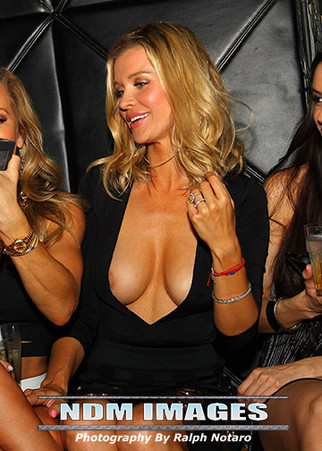 Joanna Krupa wardrobe malfunction during girls night out at Mynt Lounge in South Beach