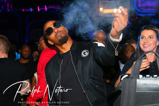 Jamie Foxx poses for photos at Kuro before hosting the Culinary Cookoff event at DAER nightclub