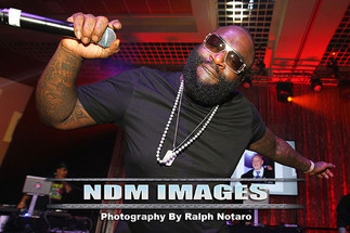 Rick Ross performs at the ICD Christmas Party