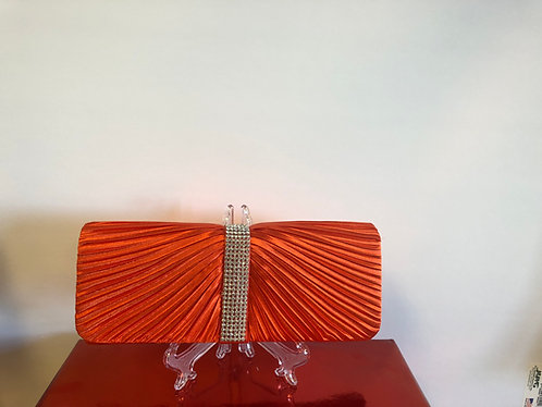 Orange satin ribbed clutch with rhinestone accent