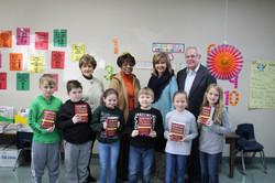 Third Graders receive dictionaries.