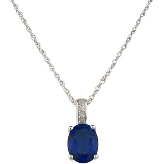 September: White Gold Oval Sapphire and Diamond Pendant