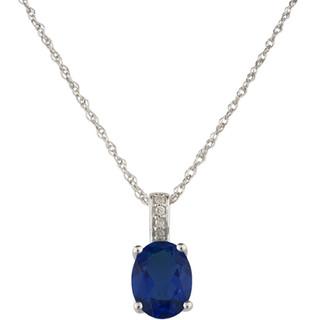 September: White Gold Oval Sapphire and Diamond Pendant