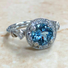 Round Aquamarine and Diamond Ring