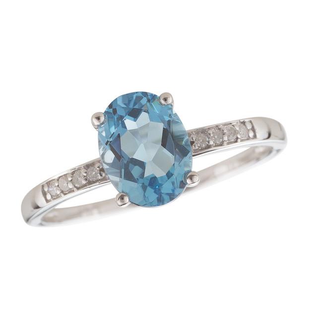 December: White Gold Oval Blue Topaz and Diamond Ring