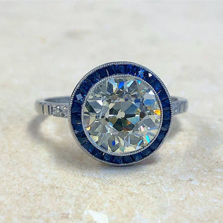 Diamond and Sapphire Halo Engagement Ring