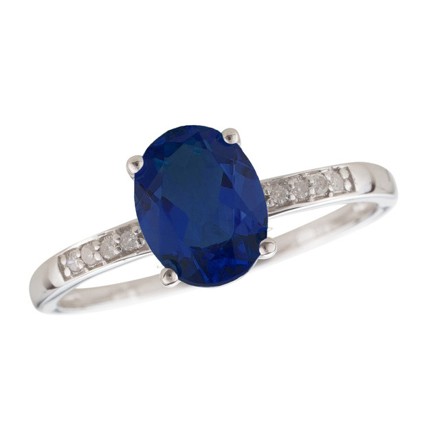 September: White Gold Oval Sapphire and Diamond Ring
