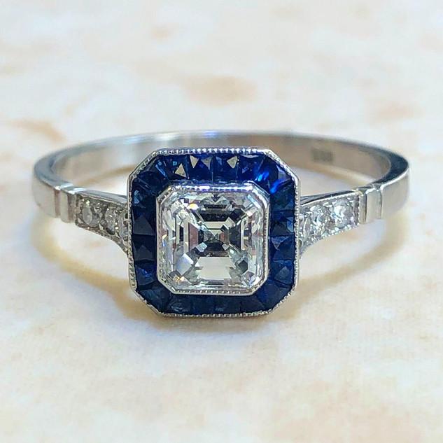 0.63 Carat Asscher Cut Diamond and Sapphire Halo Engagement Ring