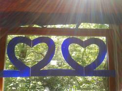 double heart in window sunrays.jpeg