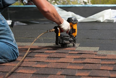 Roofing Professional installing shingles on roof