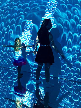 "Mother and daughter in interactive immersive room ""illusion"""