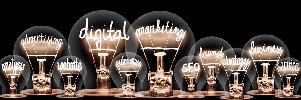 Digital marketing phrases in lit light bulbs