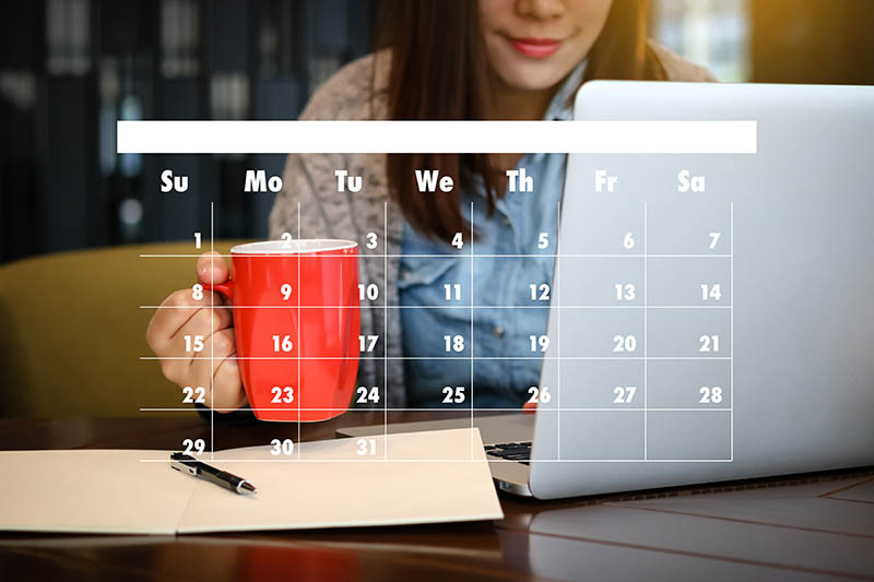 Woman with laptop and coffee, with a calendar superimposed over the image