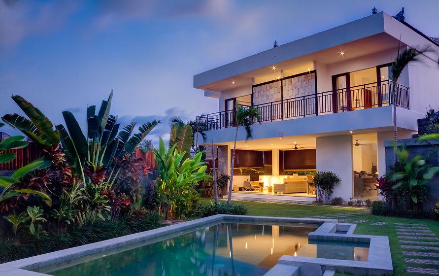 Tropical villa view with garden, swimmin